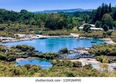 Panoramic view of geothermal pools in Rotorua, New Zealand.