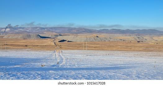 panoramic view of giant gob piles from open pit coal mining Sagan Nur, Republic of Buryatia, Russia