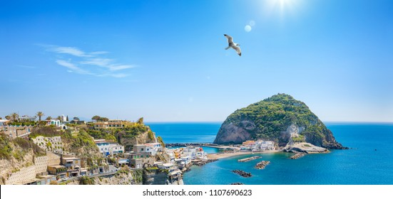 Panoramic view of giant rock in sunny summer day near small village Sant'Angelo on Ischia island, Italy