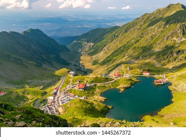 Panoramic view of glacial Lake Balea with Transfagarasan road in most famous place of Romania