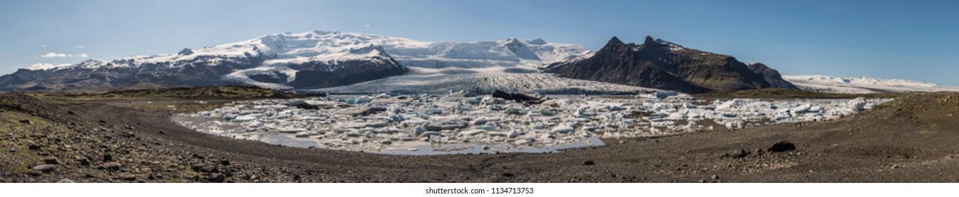 Panoramic view of Fjallsárlón glacier lagoon in Iceland.