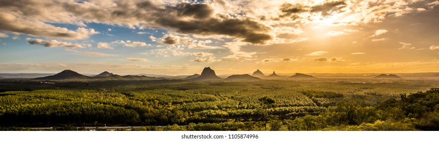 Panoramic view of Glass House Mountains at sunset visible from Wild Horse Mountain Lookout, Australia