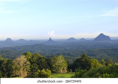 Panoramic view of the Glasshouse Mountains, Sunshine Coast, Queensland, Australia. These are a group of hills that rise abruptly from the coastal plain.