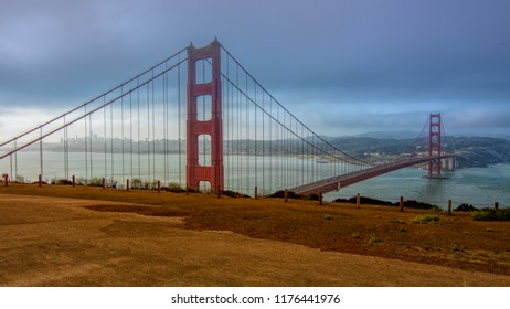Panoramic view of the Golden Gate Bridge in the morning viewed from Battery Spencer, a Fort Baker site, featuring the typical summer fog of San Francisco's bay, California, USA