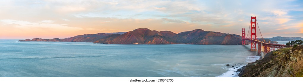 Panoramic view of the Golden Gate Bridge at sunrise from the Battery Godfrey overlook.