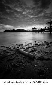 Panoramic view of golden hour at Batu Musang jetty, Penang in black and white