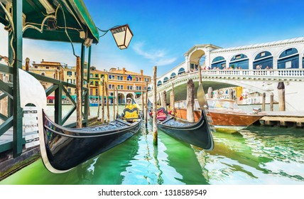 Panoramic view of Gondolas and boat at their moorings against famous Rialto Bridge at Grand Canal in Venice, Italy, Europe - Image