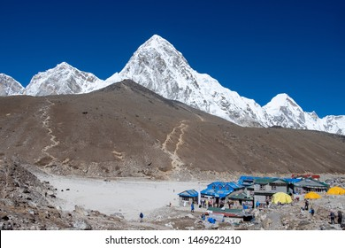 Panoramic view of Gorak Shep and Kala Patthar with snow mountain peaks  under a deep blue sky during a clear sunny day, Everest base camp trekking trail, Sagarmatha National Park, Nepal