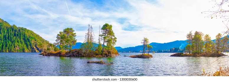 Panoramic view of Gordon Bay Park at Cowichan Lake in Vancouver Island during the fall season, taken in BC, Canada