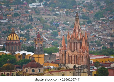 Panoramic view of the Gothic architecture Parroquia de San Miguel Arcángel and the historic town of San Miguel de Allende in Guanajuato Mexico.