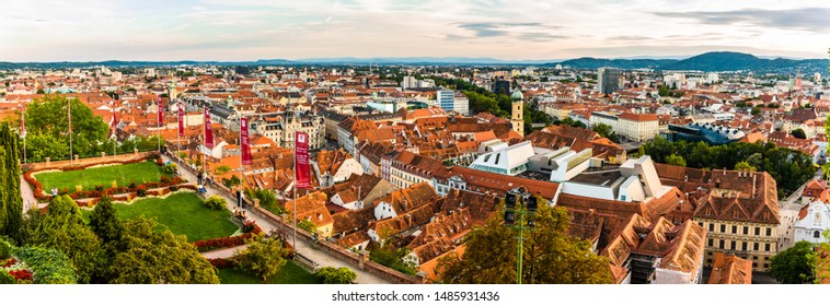 Panoramic view at Graz city with his famous buildings. River mur, clock tower, art museum, town hall. Famous tourist destination in Austria