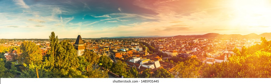 Panoramic view at Graz city with his famous buildings. River mur, clock tower, art museum, town hall. Photo with colorfull light leak and flare