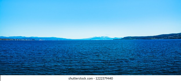 Panoramic view of great lake Taupo with volcanic cones of Ruapehu towering in the background. North Island Volcanic Plateau, New Zealand