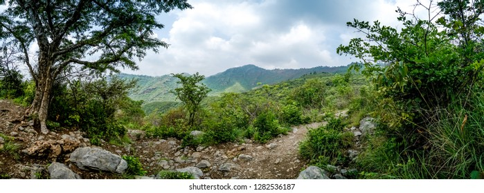 Panoramic view of green mountains from hiking trail in Islamabad, Pakistan