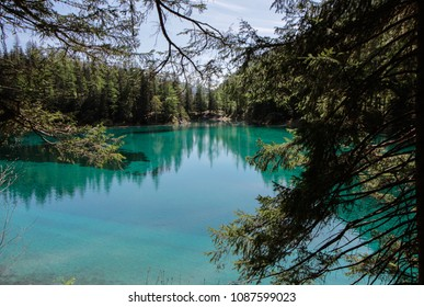 Panoramic view of the Gruner See or the Green Lake, from Styria, Austria.  Turquoise shade, perfectly still water, with pine trees silhouette, hot spring day.