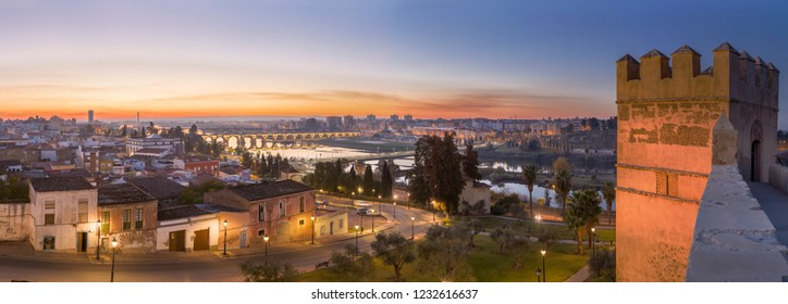 Panoramic view of Guadiana river from arabic citadel, Badajoz, Spain. Badajoz skyline at dusk