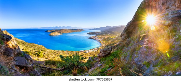 Panoramic view of the gulf of Elounda with Spinalonga island. View from the mountain through a cave, Crete, Greece.