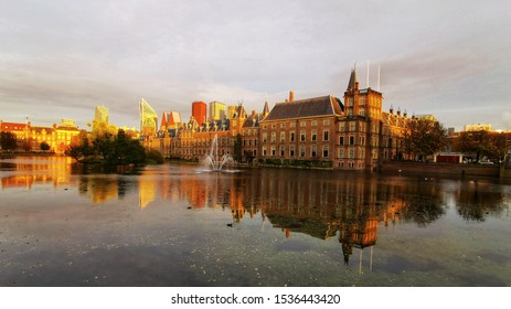 Panoramic view of the Hague skyline: houses of Parliament, Binnenhof, Mauritshuis, the Hague historic museum. Sunset autumn view. Fall colours. Reflections
