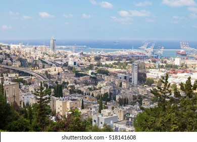 Panoramic view of Haifa, Israel. City streets, trees, sea port and skyscrapers