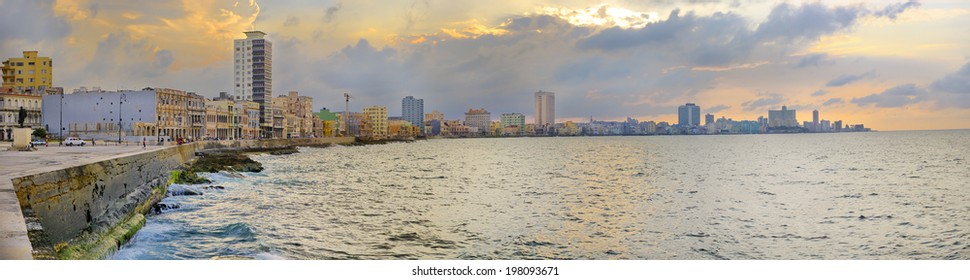 Panoramic view of Havana bay and city skyline along the waterfront (malecon) at sunset
