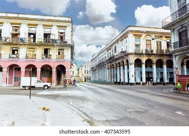 Panoramic view of Havana street with road, crumbling buildings at sunny day. Havana, Cuba life. Road in Havana. Colorful buildings and road in Havana, Cuba traditional architecture landscape