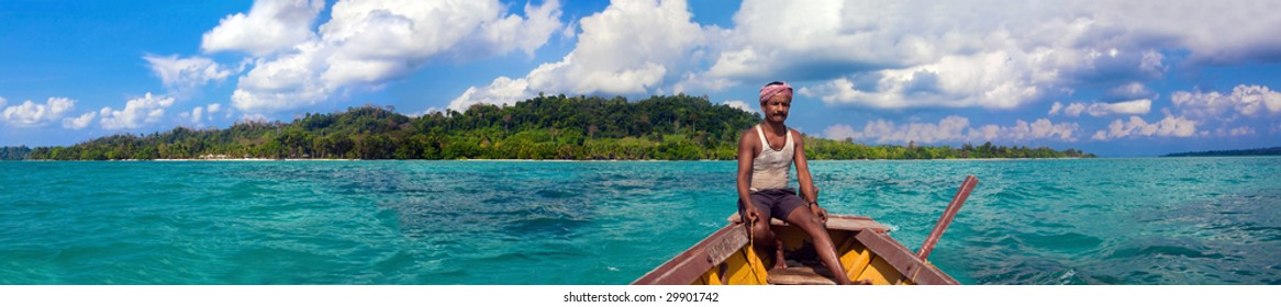 Panoramic view of the Havelock Island (Andaman and Nicobar Islands, India) with the fisherman's boat.