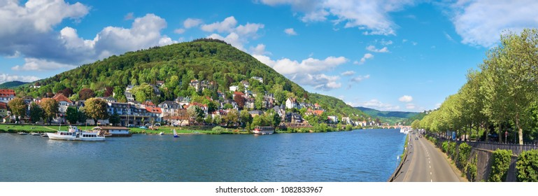 Panoramic view of Heidelberg and Neckar river taken from Karl Theodor Bridge on a bright sunny day