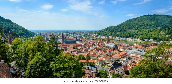 Panoramic view of Heidelberg old town in Germany with the Church of Holy Spirit and the St. Peter Church and the old bridge (Alte Bruecke, aka Carl Theodor Bridge crossing the Neckar
