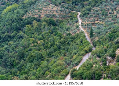 panoramic view from height of bird's flight of a landscape with the twisting rural highway and the old power line