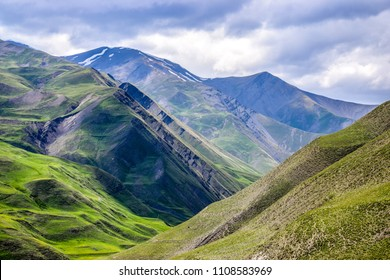 Panoramic view of the High Caucasus mountains during a stormy summer day perfect for hiking - nature theme alpine background with green steep hills, Azerbaijan, 2018
