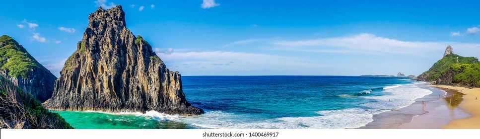 panoramic view of the hill two brothers with view of the beach cacimba do padre in fernando de noronha pernambuco brazil with a beautiful blue sea with several shades of blue and green, blue sky with