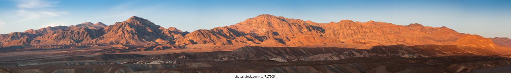 Panoramic view at hills lighted by sunset light in Death Valley, California, USA