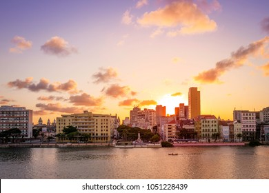 Panoramic view of the historic architecture of the city of Recife in Pernambuco, Brazil showcasing its famous Saint Joseph neighbouhood by the Capibaribe river at sunset.