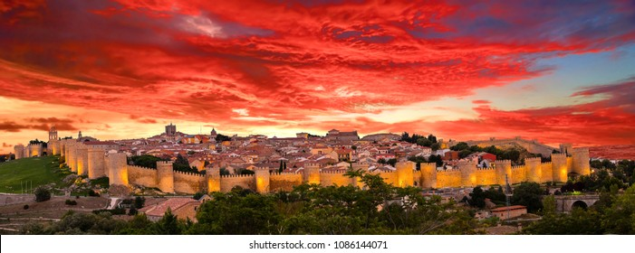 Panoramic view of the historic city of Avila, Spain with its famous medieval town walls surrounding the city at sunset. UNESCO World Heritage. Called the Town of Stones and Saints