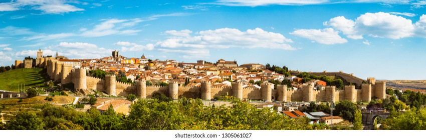 Panoramic view of the historic city of Avila from the Mirador of Cuatro Postes, Spain, with its famous medieval town walls. UNESCO World Heritage. Called the Town of Stones and Saints