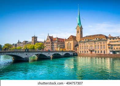 Panoramic view of the historic city center of Zurich with famous Fraumunster Church and munsterbrucke with river Limmat on a sunny day with blue sky, Canton of Zurich, Switzerland