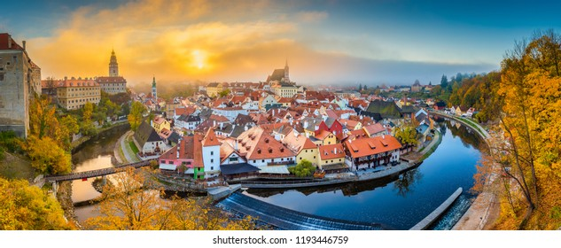 Panoramic view of the historic city of Cesky Krumlov with famous Cesky Krumlov Castle in beautiful morning light at sunrise with mystic fog in fall, Czech Republic
