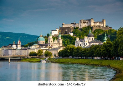 Panoramic view of the historic city of Salzburg with Fortress Hohensalzburg in the background as seen from river Salzach in Salzburg, Austria
