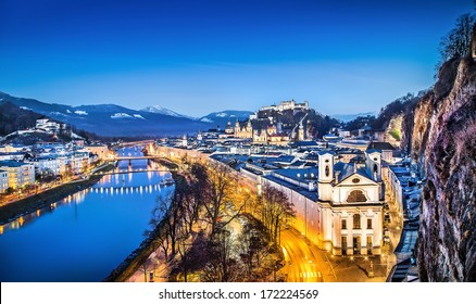 Panoramic view of historic city of Salzburg with Festung Hohensalzburg and river Salzach at blue hour, Salzburger Land, Austria