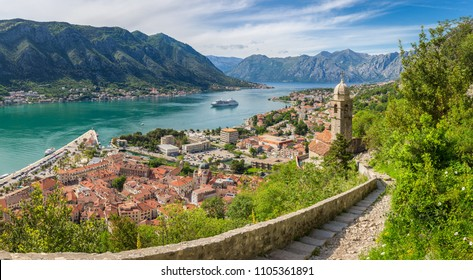 Panoramic view of the historic town of Kotor, with famous Bay of Kotor on a beautiful sunny day with blue sky and clouds in summer, Montenegro, Balkans region, southern Europe