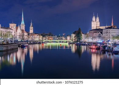 Panoramic view of historic Zurich city center with famous Fraumunster Church and river Limmat at Lake Zurich , in twilight, Canton of Zurich, Switzerland
