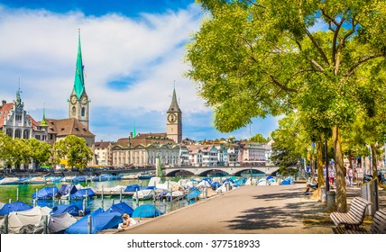 Panoramic view of historic Zurich city center with famous Fraumunster and St. Peter Churches and river Limmat at Lake Zurich on a sunny day with clouds in summer, Canton of Zurich, Switzerland