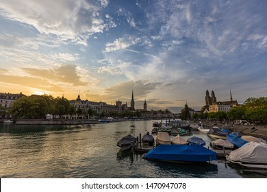 Panoramic view of historic Zurich downtown with Fraumunster and Grossmunster churches at lake zurich during sunset, Switzerland