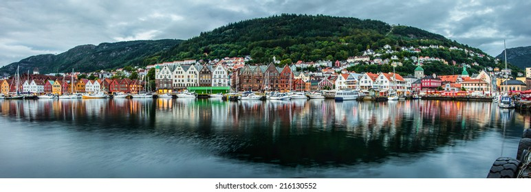 Panoramic view to historical part of Bergen city in Norway, including fabous Bryggen street  (UNESCO world heritage) in twilight lightning - urban background
