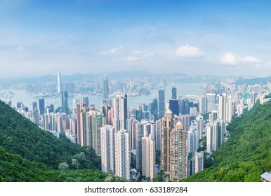 Panoramic view of Hong Kong cityscape on a beautiful sunny day.