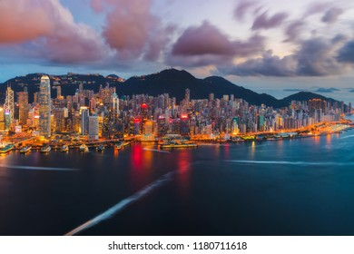 Panoramic view of Hong Kong island and Victoria harbor in sunset
