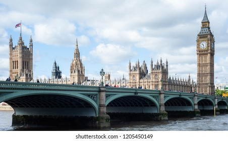 Panoramic view of the Houses of Parliament, Palace of Westminster and Westminster Bridge in London, UK, on a beautiful windy day