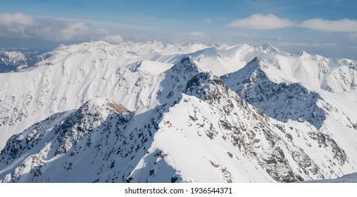 Panoramic view from Hruba kopa peak on Western Tatra mountains or Rohace panorama. Winter ski touring in Slovakia