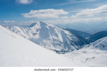 Panoramic view from Hruba kopa peak on Western Tatra mountains or Rohace panorama. Winter ski touring in Slovakia.  Sunny weather.