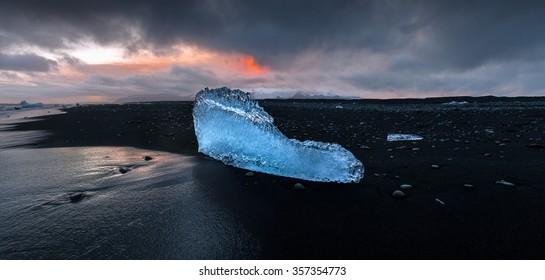 Panoramic view of ice fragment on the black beach of Jokulsarlon, Vatnajokull N.P., Iceland.